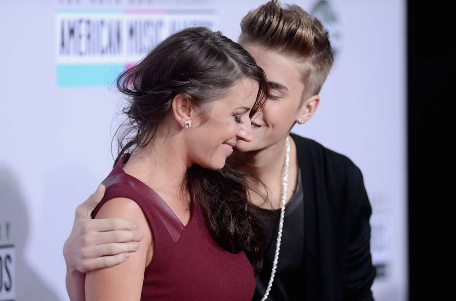 Singer Justin Bieber (R) and mother Pattie Malette attend the 40th American Music Awards held at Nokia Theatre L.A. Live on November 18, 2012 in Los Angeles, California.  (Photo by Jason Merritt/Getty Images) Photo: Jason Merritt, Getty Images / 2012 Getty Images