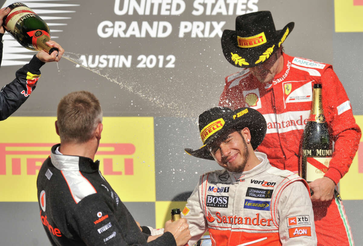 Winner Lewis Hamilton is sprayed with champagne after the United States Grand Prix Sunday at the Circuit of the America's in Austin.