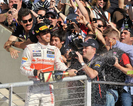 Winner Lewis Hamilton sprays champagne after the United States Grand Prix Sunday at the Circuit of the America's in Austin. Photo: Express-News
