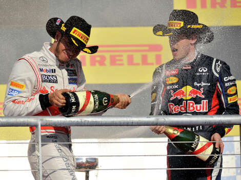 Winner Lewis Hamilton and Sebastian Vettel react after the United States Grand Prix Sunday at the Circuit of the America's in Austin. Photo: Express-News