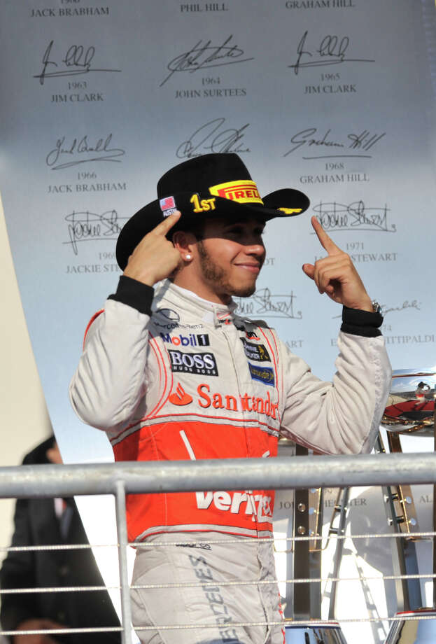 Lewis Hamilton points to his first palce hat after winning the United States Grand Prix Sunday at the Circuit of the America's in Austin. Photo: Express-News