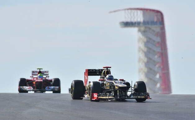 Kimi Raikkonen leads Fernando Alonso during the United States Grand Prix Sunday at the Circuit of the America's in Austin. Photo: Express-News
