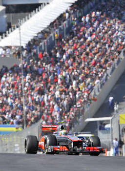 In front of a huge crowd, Englishman Lewis Hamilton crests the turn 1 hill during the United States Grand Prix Sunday at the Circuit of the America's in Austin. Photo: Express-News