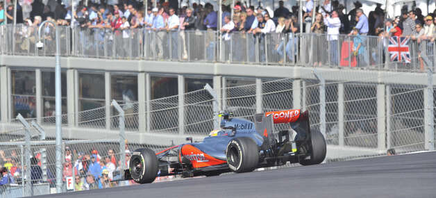 Lewis Hamilton exits turn 1 during the United States Grand Prix Sunday at the Circuit of the America's in Austin. Photo: Express-News