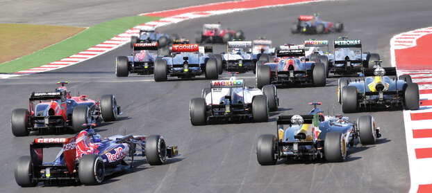 Formula 1 race cars get close to each other after exiting turn 1 during the United States Grand Prix Sunday at the Circuit of the America's in Austin. Photo: Express-News