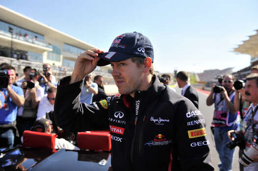 Sebastian Vettel adjusts his hat during the United States Grand Prix Sunday at the Circuit of the America's in Austin. Photo: Express-News