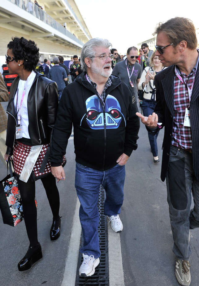 Director George Lucas talks with a friend prior to the United States Grand Prix Sunday at the Circuit of the America's in Austin. Photo: Express-News
