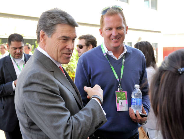 Texas Governor Rick Perry talks with Christian Epp of Tilke and Associates prior to the United States Grand Prix Sunday at the Circuit of the America's in Austin. Tilke and Associates designed the 3.4 mile circuits and grounds. Photo: Express-News