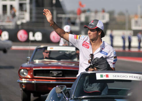 Mexican driver Sergio Perez waves to the crowd during the drivers parade prior to the United States Grand Prix Sunday at the Circuit of the America's in Austin. Photo: Express-News