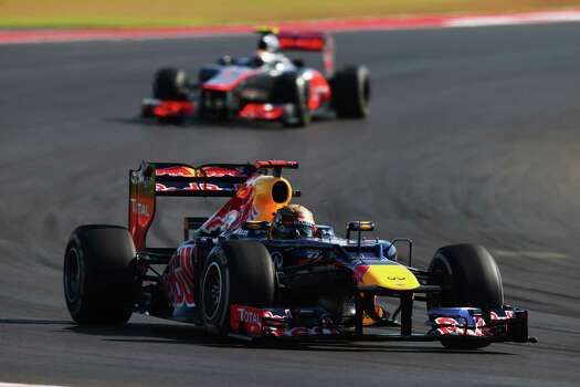 Sebastian Vettel of Germany and Red Bull Racing leads from Lewis Hamilton of Great Britain and McLaren during the United States Formula One Grand Prix at the Circuit of the Americas on November 18, 2012 in Austin, Texas. Photo: Clive Mason, Getty Images / 2012 Getty Images