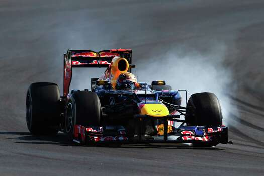 Sebastian Vettel of Germany and Red Bull Racing locks his wheels during the United States Formula One Grand Prix at the Circuit of the Americas on November 18, 2012 in Austin, Texas. Photo: Clive Mason, Getty Images / 2012 Getty Images