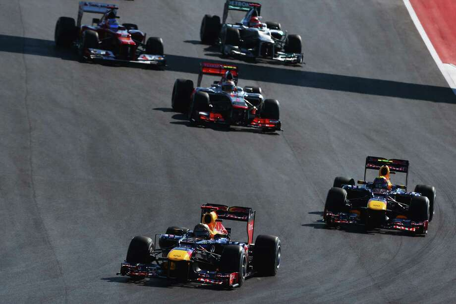 Sebastian Vettel of Germany and Red Bull Racing leads the field towards turn two at the start of the United States Formula One Grand Prix at the Circuit of the Americas on November 18, 2012 in Austin, Texas. Photo: Paul Gilham, Getty Images / 2012 Getty Images