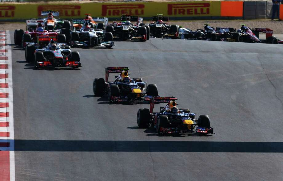 Sebastian Vettel of Germany and Red Bull Racing leads the field through the first corner at the start of the United States Formula One Grand Prix at the Circuit of the Americas on November 18, 2012 in Austin, Texas. Photo: Paul Gilham, Getty Images / 2012 Getty Images