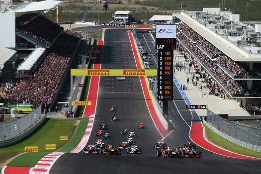 Sebastian Vettel of Germany and Red Bull Racing leads the field up the hill towards the first corner at the start of the United States Formula One Grand Prix at the Circuit of the Americas on November 18, 2012 in Austin, Texas. Photo: Mark Thompson, Getty Images / 2012 Getty Images