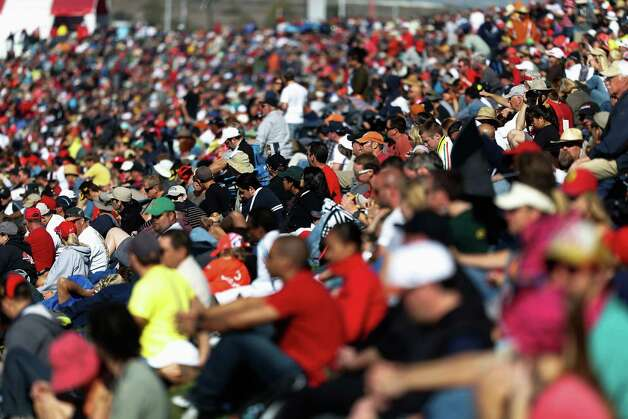 Race fans are seen amongst the crowd of 117,429 for the United States Formula One Grand Prix at the Circuit of the Americas on November 18, 2012 in Austin, Texas. Photo: Peter Fox, Getty Images / 2012 Getty Images