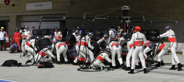 McLaren Mercedes driver Lewis Hamilton of Britain gets a pit service during the Formula One US Grand Prix auto race at the Circuit of the Americas race track in Austin, Texas, on November 18, 2012.    AFP PHOTO/POOL/Luca BrunoLUCA BRUNO/AFP/Getty Images Photo: LUCA BRUNO, Getty Images / AFP