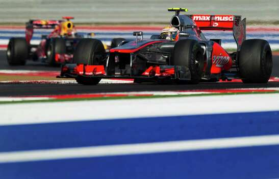 Vodafone McLaren Mercedes driver Lewis Hamilton (R) of Britain is followed by Red Bull Racing driver Sebastian Vettel (L) of Germany through turn 17 during the United States Formula One Grand Prix at the Circuit of the Americas on November 17, 2012 in Austin, Texas. A bold passing maneuver at the end of a long straightway slipped Hamilton past Vettel allowing Hamilton on to win the US Grand Prix on Novermber 17 in the first Formula One race on American soil since 2007.    AFP PHOTO/Jim WATSONJIM WATSON/AFP/Getty Images Photo: JIM WATSON, Getty Images / AFP