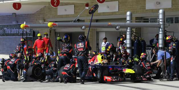 Red Bull driver Sebastian Vettel of Germany gets a pit service during the Formula One US Grand Prix auto race at the Circuit of the Americas race track in Austin, Texas, on November 18, 2012      AFP PHOTO/POOL/Luca BrunoLUCA BRUNO/AFP/Getty Images Photo: LUCA BRUNO, Getty Images / AFP