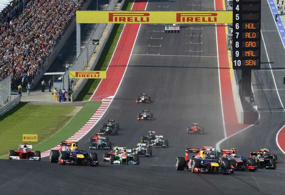 Cars go into the first turn during the start of the United States Formula One Grand Prix at the Circuit of the Americas on November 18, 2012 in Austin, Texas.   AFP PHOTO / TIMOTHY A. CLARYTIMOTHY A. CLARY/AFP/Getty Images Photo: TIMOTHY A. CLARY, Getty Images / AFP