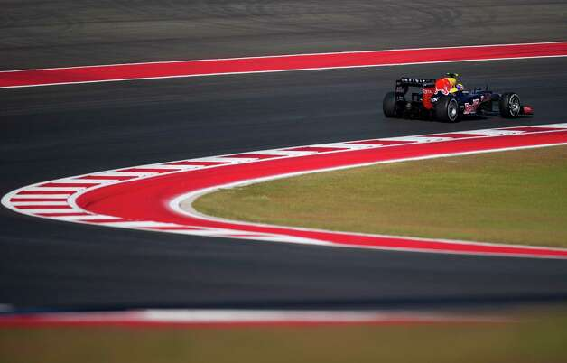 Germany's Sebastian Vettel of Team Red Bull Racing takes turn 2 at the start of the United States Formula One Grand Prix at the Circuit of the Americas on November 17, 2012 in Austin, Texas.      AFP PHOTO/Jim WATSONJIM WATSON/AFP/Getty Images Photo: JIM WATSON, Getty Images / AFP
