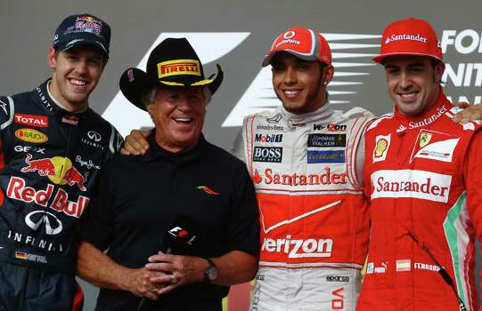 AUSTIN, TX - NOVEMBER 18:  Race winner Lewis Hamilton (2nd right) of Great Britain and McLaren appears on the podium with second placed Sebastian Vettel (left) of Germany and Red Bull Racing, third placed Fernando Alonso (right) of Spain and Ferrari and former F1 World Champion Mario Andretti (2nd left) following the United States Formula One Grand Prix at the Circuit of the Americas on November 18, 2012 in Austin, Texas. Photo: Paul Gilham, Getty Images / 2012 Getty Images