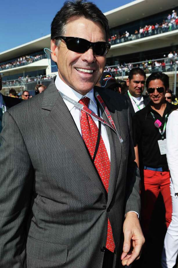 AUSTIN, TX - NOVEMBER 18:  Rick Perry the Governor of Texas attends the United States Formula One Grand Prix at the Circuit of the Americas on November 18, 2012 in Austin, Texas. Photo: Mark Thompson, Getty Images / 2012 Getty Images