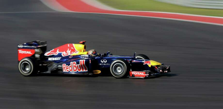 Red Bull driver Sebastian Vettel, of Germany. steers his car during the Formula One U.S. Grand Prix auto race at the Circuit of the Americas Sunday, Nov. 18, 2012, in Austin, Texas. Vettel finished second. (AP Photo/Eric Gay) Photo: Eric Gay, Associated Press / AP