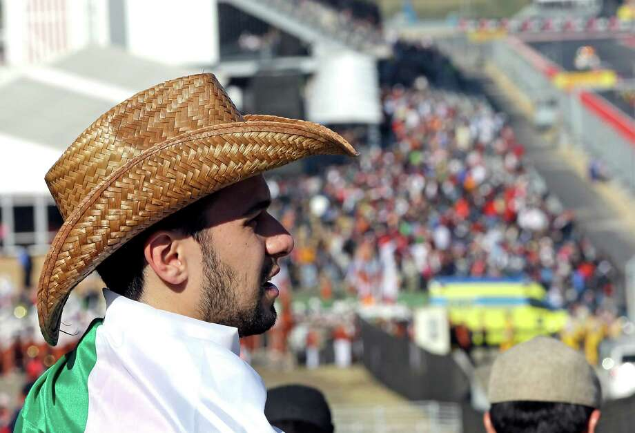 A fan from Brazil waits for the first running of the Formula One U.S. Grand Prix auto race at the Circuit of the Americas Sunday, Nov. 18, 2012, in Austin, Texas. (AP Photo/David J. Phillip) Photo: David J. Phillip, Associated Press / AP