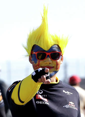 Minh Tran, of Austin, Texas, waits for the start of the Formula One U.S. Grand Prix auto race at the Circuit of the Americas Sunday, Nov. 18, 2012, in Austin. (AP Photo/David J. Phillip) Photo: David J. Phillip, Associated Press / AP