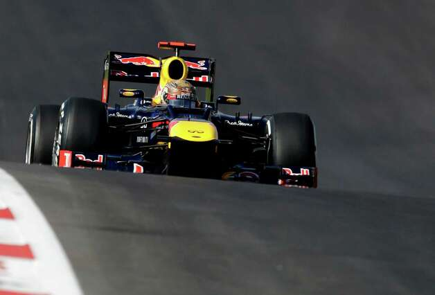 Red Bull driver Sebastian Vettel, of Germany, steers his car during the Formula One U.S. Grand Prix auto race at the Circuit of the Americas Sunday, Nov. 18, 2012, in Austin, Texas. Vettel finished second. (AP Photo/Eric Gay) Photo: Eric Gay, Associated Press / AP