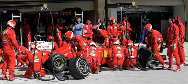 Ferrari driver Fernando Alonso of Spain gets a pit service during the Formula One U.S. Grand Prix auto race, at the Circuit of the Americas race track, in Austin, Texas, Sunday, Nov. 18, 2012. (AP Photo/Luca Bruno/Pool) Photo: Luca Bruno, Associated Press / AP POOL