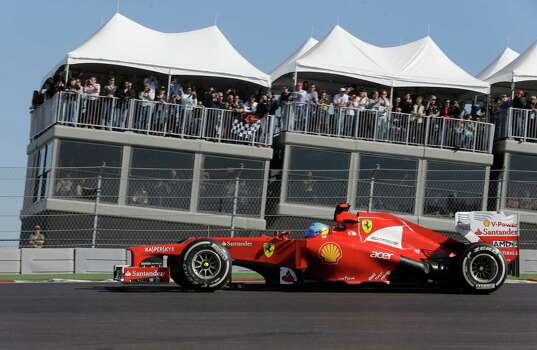 Ferrari driver Fernando Alonso of Spain steers his car during the Formula One U.S. Grand Prix auto race at the Circuit of the Americas Sunday, Nov. 18, 2012, in Austin, Texas. (AP Photo/Luca Bruno) Photo: Luca Bruno, Associated Press / AP