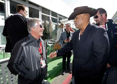 Mario Andretti, left talks to Willy T. Ribbs before the Formula One U.S. Grand Prix auto race at the Circuit of the Americas Sunday, Nov. 18, 2012, in Austin, Texas. (AP Photo/Darron Cummings) Photo: Darron Cummings, Associated Press / AP
