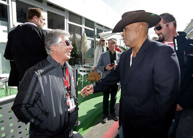 Mario Andretti, left talks to Willy T. Ribbs before the Formula One U.S. Grand Prix auto race at the Circuit of the Americas Sunday, Nov. 18, 2012, in Austin, Texas. (AP Photo/Darron Cummings) Photo: Darron Cummings, Associated Press / AP