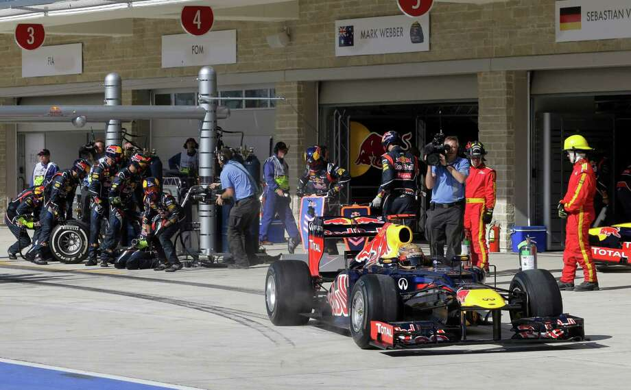 Red Bull driver Sebastian Vettel of Germany steers his car after he gets a pit service during the Formula One U.S. Grand Prix auto race, at the Circuit of the Americas race track, in Austin, Texas, Sunday, Nov. 18, 2012. (AP Photo/Luca Bruno/Pool) Photo: Luca Bruno, Associated Press / AP POOL