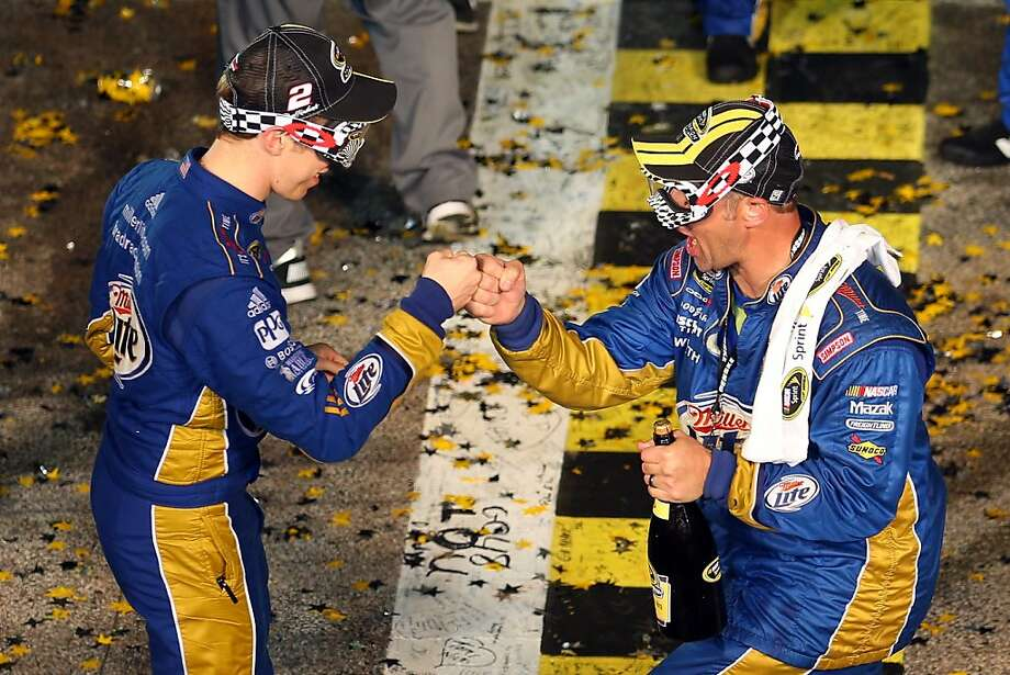 HOMESTEAD, FL - NOVEMBER 18:  Brad Keselowski, driver of the #2 Miller Lite Dodge, celebrates with a crew member in Champion Victory Lane after winning the series championship and finishing in fifteenth place for the NASCAR Sprint Cup Series Ford EcoBoost 400 at Homestead-Miami Speedway on November 18, 2012 in Homestead, Florida.  (Photo by Todd Warshaw/Getty Images) Photo: Todd Warshaw, Getty Images