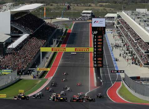 Red Bull driver Sebastian Vettel of Germany leads the field into the first turn during the Formula One U.S. Grand Prix auto race at the Circuit of the Americas Sunday, Nov. 18, 2012, in Austin, Texas. (AP Photo/Eric Gay) Photo: Eric Gay, Associated Press / AP