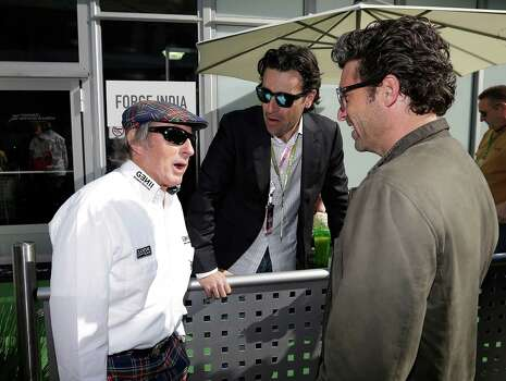 Jackie Stewart, left, talks to IndyCar diver Dario Franchitti, middle, and Patrick Dempsey before the running of the Formula One U.S. Grand Prix auto race at the Circuit of the Americas Sunday, Nov. 18, 2012, in Austin, Texas. (AP Photo/Darron Cummings) Photo: Darron Cummings, Associated Press / AP