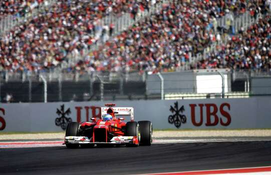 Ferrari driver Fernando Alonso of Spain steers his car during the Formula One U.S. Grand Prix auto race at the Circuit of the Americas Sunday, Nov. 18, 2012, in Austin, Texas. (AP Photo/David J. Phillip) Photo: David J. Phillip, Associated Press / AP