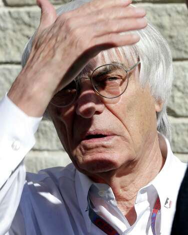 Bernie Ecclestone, president and CEO of Formula One Management, shields his eyes from the sun before the first running of the Formula One U.S. Grand Prix auto race at the Circuit of the Americas Sunday, Nov. 18, 2012, in Austin, Texas. (AP Photo/David J. Phillip) Photo: David J. Phillip, Associated Press / AP