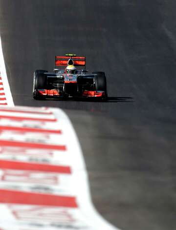McLaren Mercedes driver Lewis Hamilton, of Britain, steers his car during the Formula One U.S. Grand Prix auto race at the Circuit of the Americas Sunday, Nov. 18, 2012, in Austin, Texas. Hamilton won the race. (AP Photo/Eric Gay) Photo: Eric Gay, Associated Press / AP