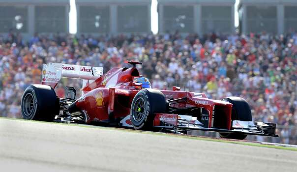 Ferrari driver Fernando Alonso of Spain steers his car during the Formula One U.S. Grand Prix auto race at the Circuit of the Americas Sunday, Nov. 18, 2012, in Austin, Texas. (AP Photo/Darron Cummings) Photo: Darron Cummings, Associated Press / AP