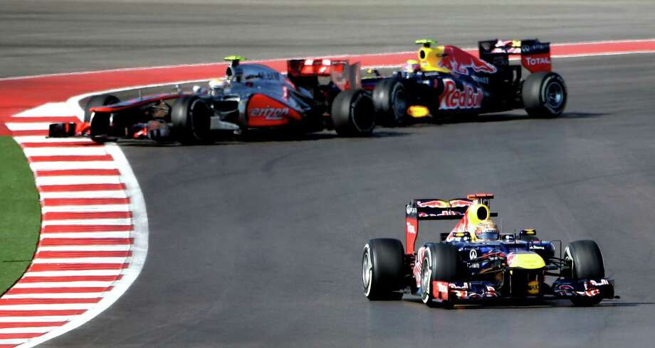 Red Bull driver Sebastian Vettel, right,  of Germany, steers his car during the Formula One U.S. Grand Prix auto race at the Circuit of the Americas Sunday, Nov. 18, 2012, in Austin, Texas. (AP Photo/David J. Phillip) Photo: David J. Phillip, Associated Press / AP