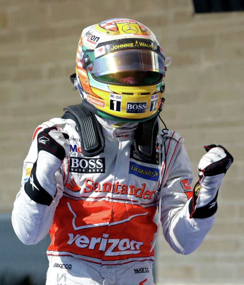 McLaren Mercedes driver Lewis Hamilton, of Britain, reacts after winning the Formula One U.S. Grand Prix auto race at the Circuit of the Americas Sunday, Nov. 18, 2012, in Austin, Texas. (AP Photo/Darron Cummings) Photo: Darron Cummings, Associated Press / AP