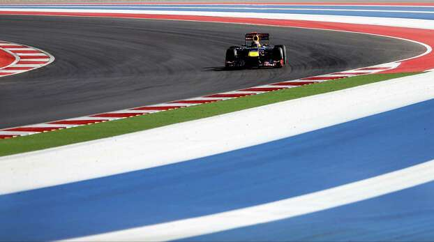Red Bull driver Sebastian Vettel, of Germany, steers his car during the Formula One U.S. Grand Prix auto race at the Circuit of the Americas Sunday, Nov. 18, 2012, in Austin, Texas. (AP Photo/David J. Phillip) Photo: David J. Phillip, Associated Press / AP