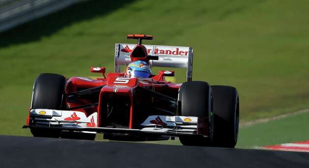 Ferrari driver Fernando Alonso of Spain steers his car during the Formula One U.S. Grand Prix auto race at the Circuit of the Americas Sunday, Nov. 18, 2012, in Austin, Texas. (AP Photo/Eric Gay) Photo: Eric Gay, Associated Press / AP