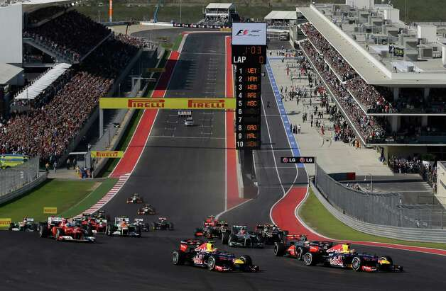 Red Bull driver Sebastian Vettel of Germany leads the field into the first turn for the start of the Formula One U.S. Grand Prix auto race at the Circuit of the Americas Sunday, Nov. 18, 2012, in Austin, Texas. (AP Photo/Eric Gay) Photo: Eric Gay, Associated Press / AP