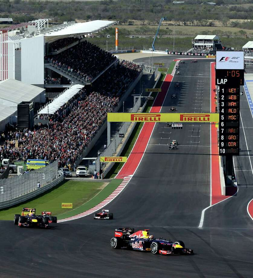 Red Bull driver Sebastian Vettel of Germany steers his car into the first turn for the start of the Formula One U.S. Grand Prix auto race at the Circuit of the Americas Sunday, Nov. 18, 2012, in Austin, Texas. (AP Photo/Eric Gay) Photo: Eric Gay, Associated Press / AP