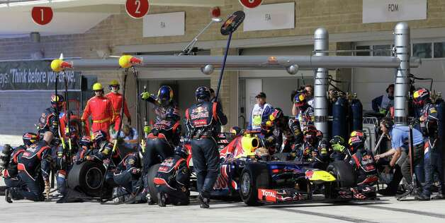 Red Bull driver Sebastian Vettel of Germany gets a pit service during the Formula One U.S. Grand Prix auto race, at the Circuit of the Americas race track, in Austin, Texas, Sunday, Nov. 18, 2012. (AP Photo/Luca Bruno/Pool) Photo: Luca Bruno, Associated Press / AP POOL