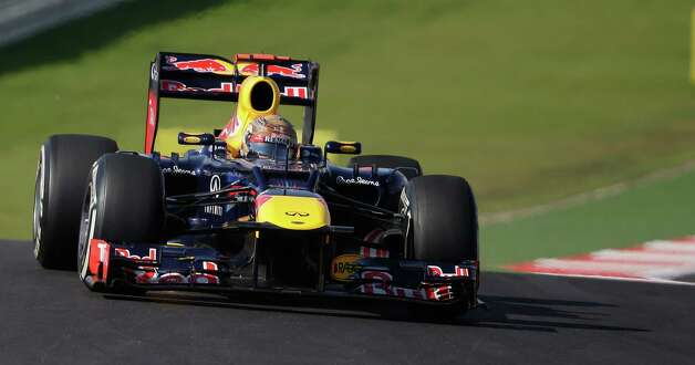 Red Bull driver Sebastian Vettel of Germany steers his car during the Formula One U.S. Grand Prix auto race at the Circuit of the Americas Sunday, Nov. 18, 2012, in Austin, Texas. (AP Photo/Eric Gay) Photo: Eric Gay, Associated Press / AP